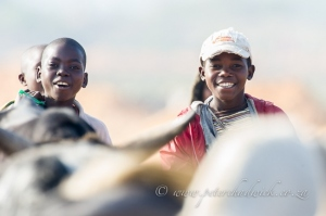 Happy Mozambican herd boys by wildlife and conservation photographer Peter Chadwick.