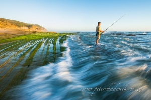 Lone fisherman by wildlife and conservation photographer Peter Chadwick