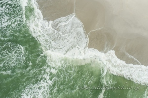 Wave break on the beach by wildlife and conservation photographer Peter Chadwick.